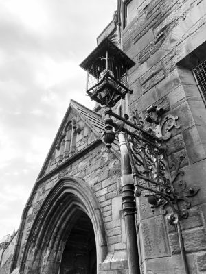Black and White Image of gothic style arch above door